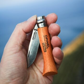 Image of an Opinel No. 08 Carbon Steel Knife held in a hand