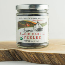Image of the front of a jar of Organic Black Garlic, Peeled