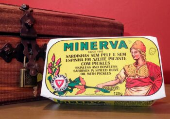 Image of the front of the packaging for Minerva Skinless and Boneless Sardines in Spiced Olive Oil with Pickles