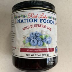 Image of the front of a jar of Red Lake Nation Foods Wild Blueberry Jam