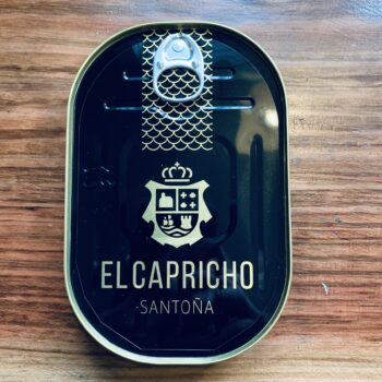 Image of a closed tin of El Capricho Bonito del Norte Fillets in EVOO