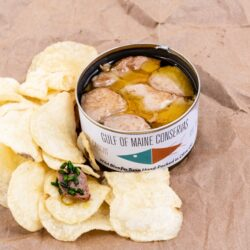 Image of an open tin of Gulf of Maine Conservas Bluefin Tuna with potato chips