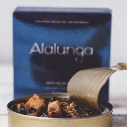 Image of the front of a package and an open tin of Artesanos Alalunga Cuttlefish In Its Own Ink