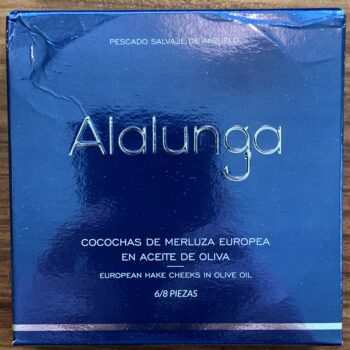 Image of the front of a package of Artesanos Alalunga Cocochas de Merluza Europea (European Hake Cheeks) in Olive Oil 6/8