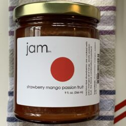 Image of the front of a jar of Strawberry Mango Passion Fruit Jam