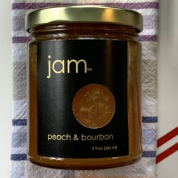 Image of the front of a jar of Peach and Bourbon Jam