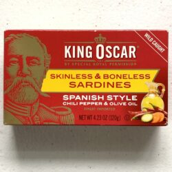Image of the front of a tin of King Oscar Skinless and Boneless Sardines Spanish Style Chili Pepper and Olive Oil