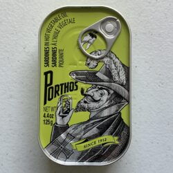 Image of the front of a tin of Porthos Sardines in Hot Vegetable Oil 3/5