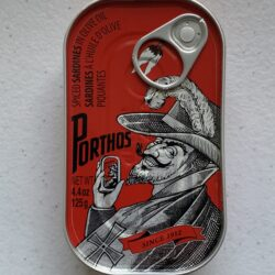 Image of the front of a tin of Porthos Spiced Sardines in Olive Oil 3/5
