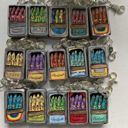 Image of a group of 15 sardine keychains