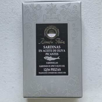 Image of the front of a package of Ramón Peña Small Sardines in Spicy Olive Oil 12/16