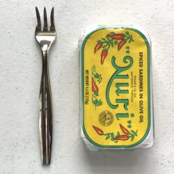 Image of a Cocktail Fork, Reed & Barton Merlot, Stainless Steel, Extra Heavy Weight next to a tin of fish for scale