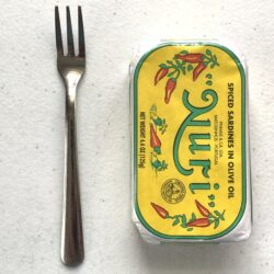 Image of a Cocktail Fork, Choice Windsor, Stainless Steel next to a tin of sardines for scale